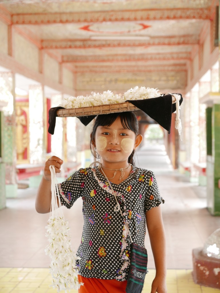 Girl selling  Jasmin flowers at the temple