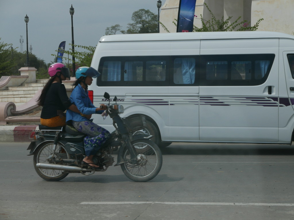 Motorbikes everywhere on the road to Mandalay - love the use of side-saddle