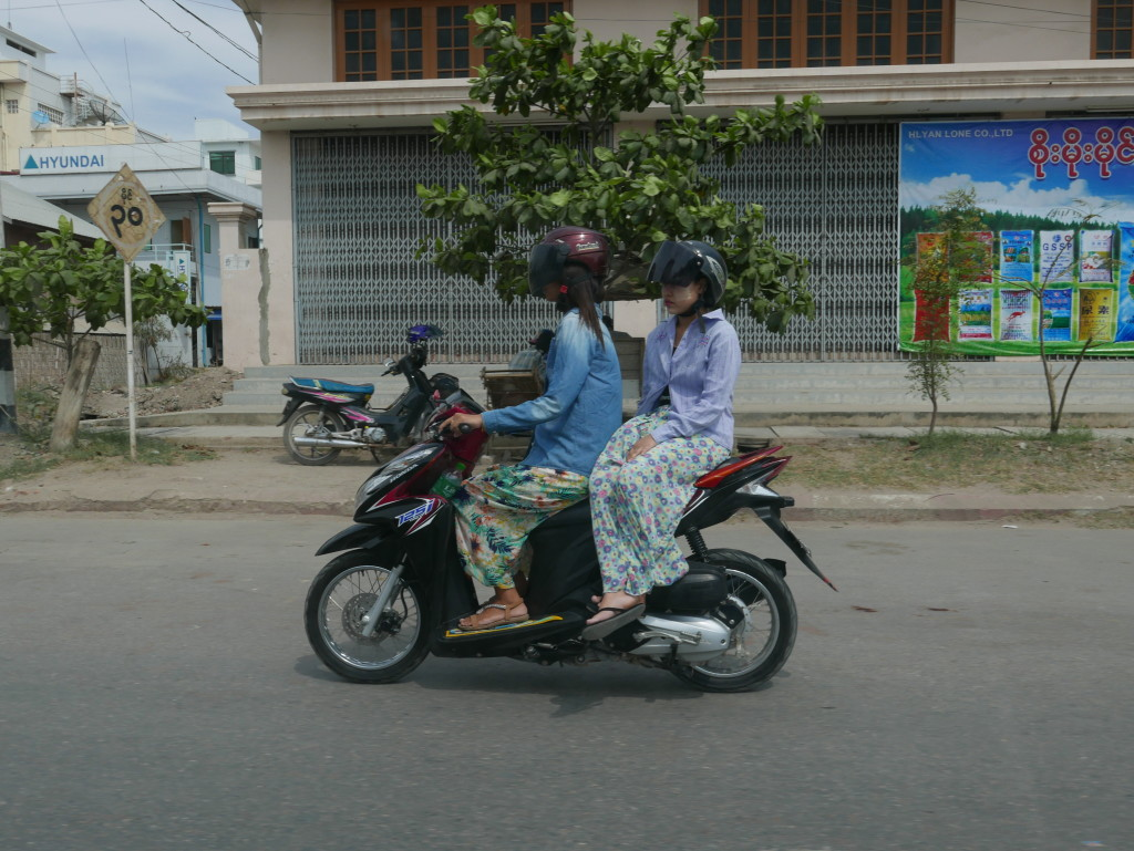 More motorbike side-saddle action on the road to Mandalay
