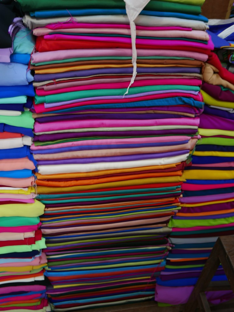 Neatly stacked cloth Bogyoke Market (Scotts Market), Yangon (Rangoon), Myanmar (Burma)