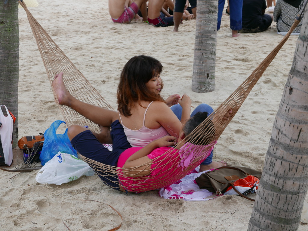 Relaxing on the beach at Sentosa Island, Singapore
