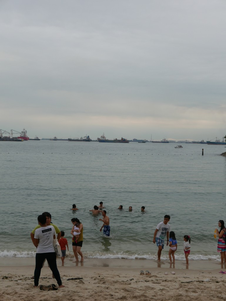 Swimmers and ships - Sentosa Island, Singapore
