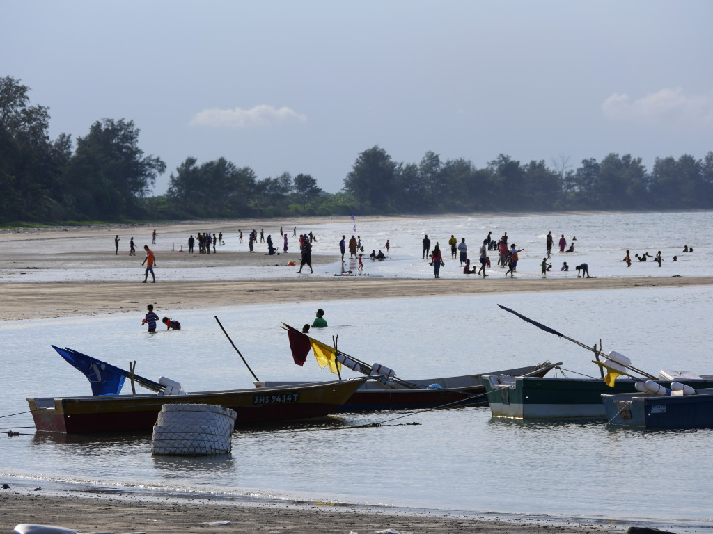 Boats and bathers - Tanjung Balau Beach
