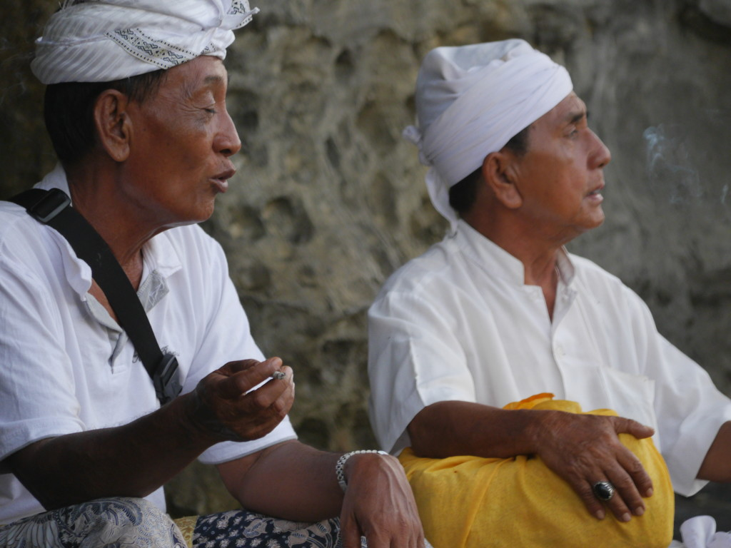 The people of Bali, Indonesia - Temple workers at Tanah Lot