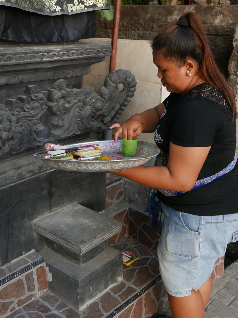 Placing offerings at a shrine