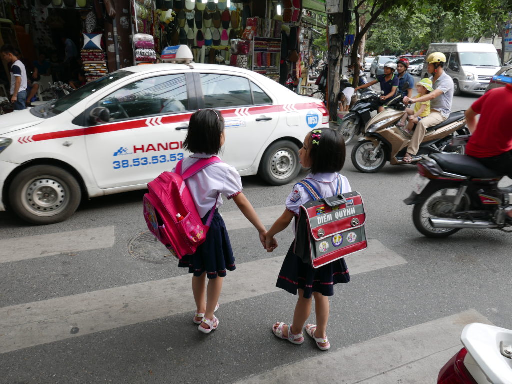 crossing the road hanoi