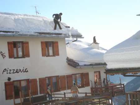 That's one way to clear snow off a roof - Courmayeur, Italy